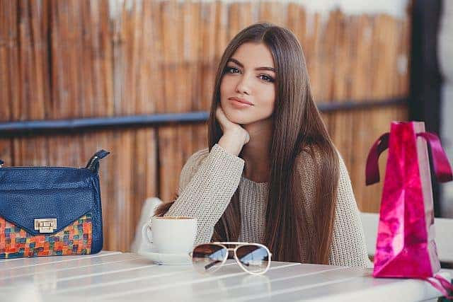 Girl with healthy straight hair in a cafe