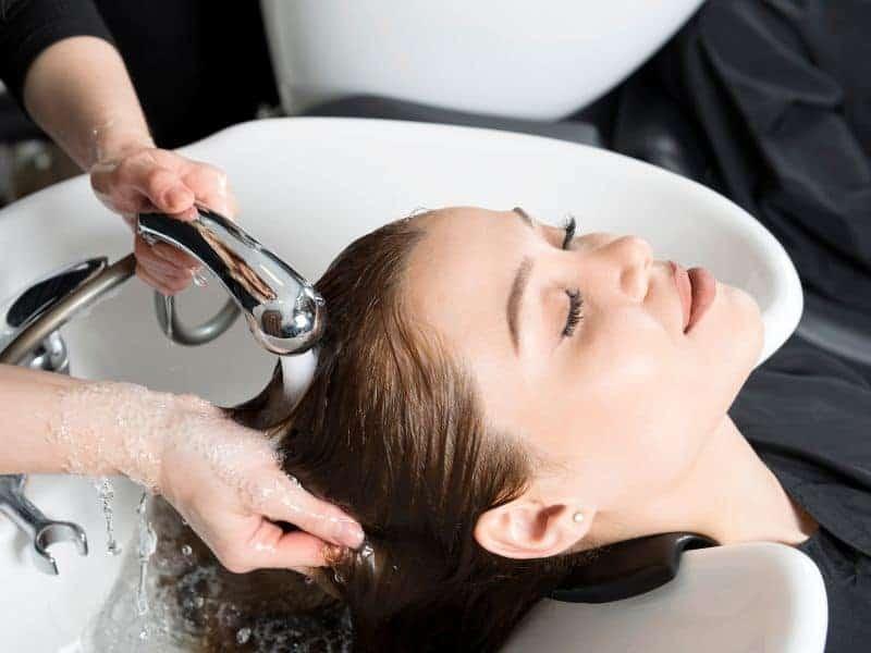 washing hair in a salon