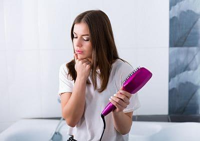 girl holding hot brush